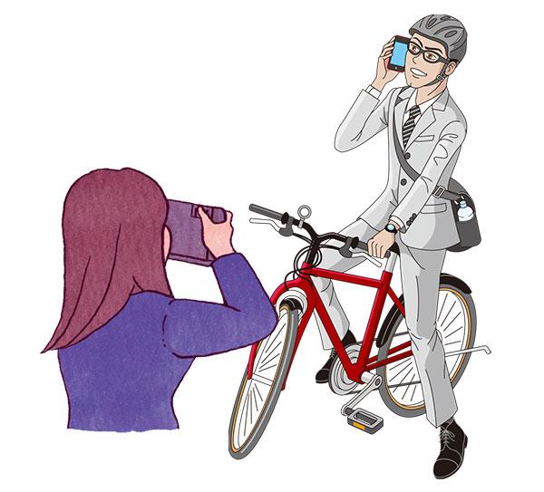 自転車と男性を撮影しているカメラマン